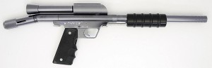a black and silver CCI Phantom Stock Play Horizontal Feedtube Pump Paintball Gun + .45 Grip Silver