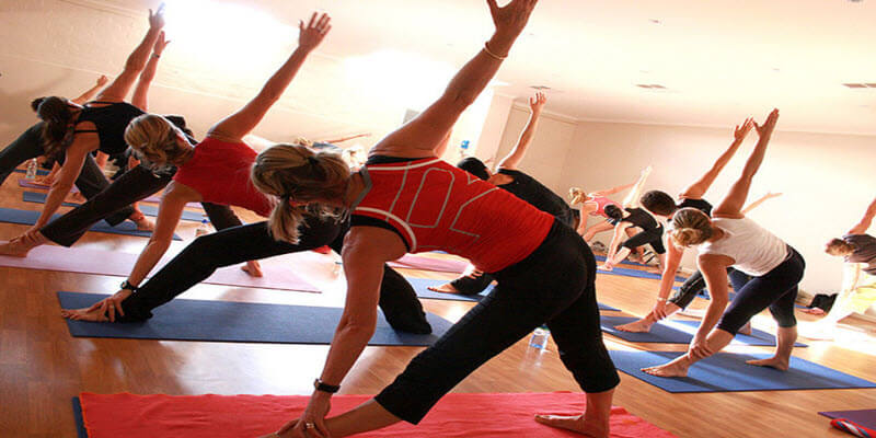 Group of people doing yoga as a team building game