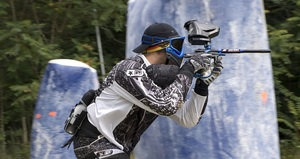 young man playing paintball