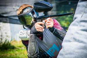 paintball player firing her gear from the paintball gun case