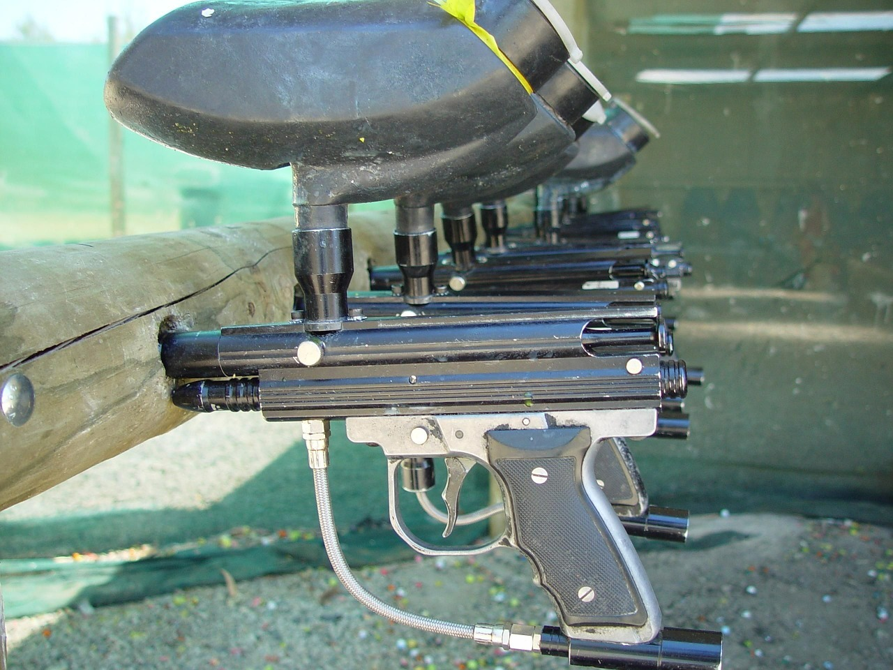 paintball guns in a rack