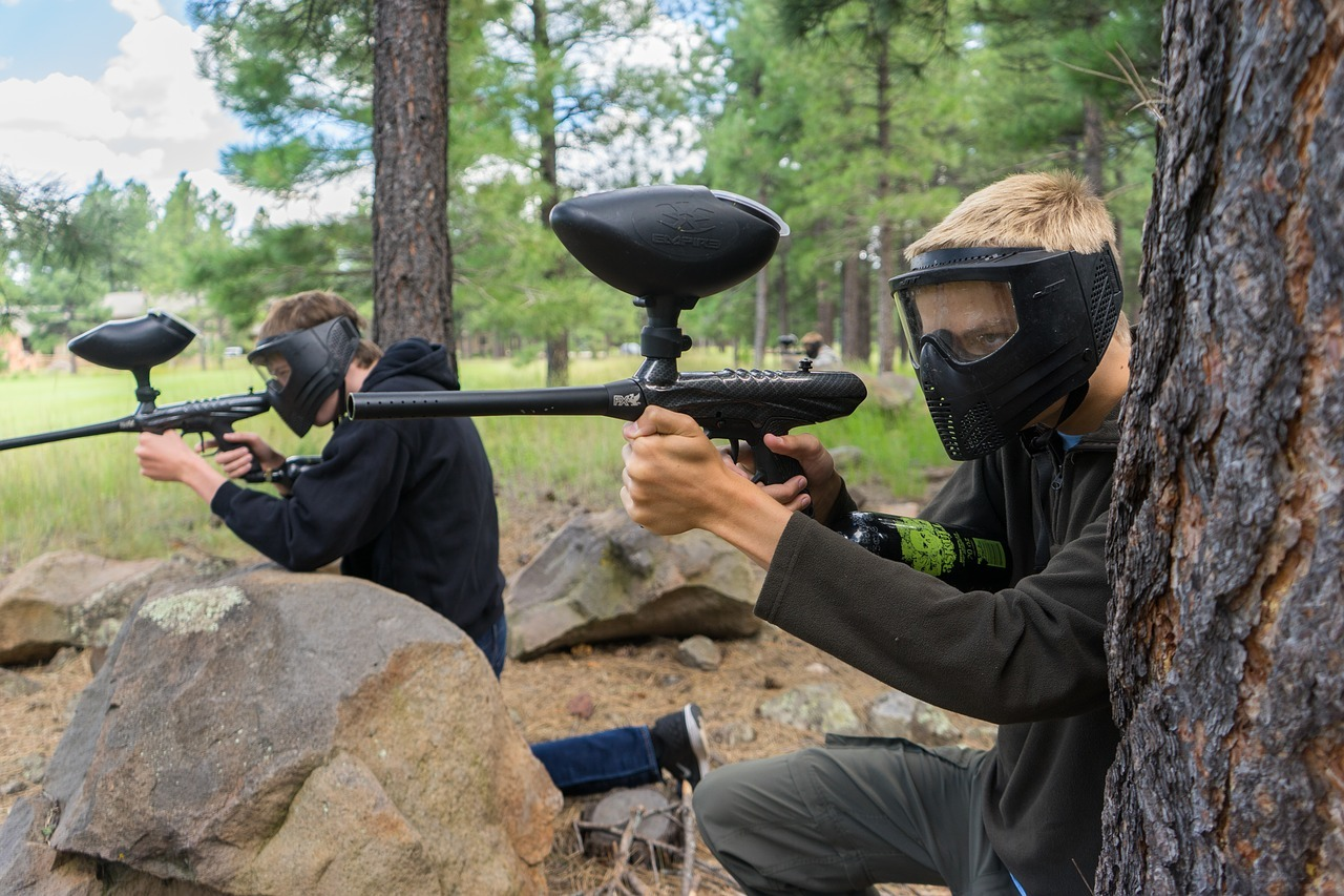 two teens playing paintball