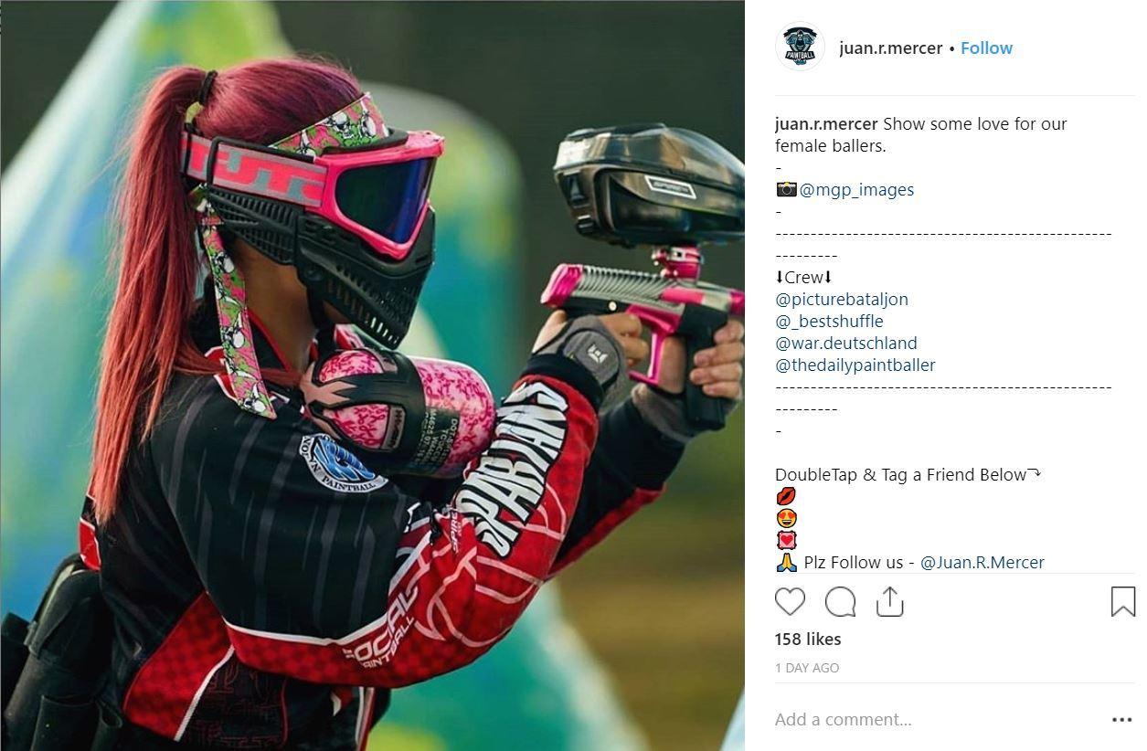 instagram image of woman paintballer with purple hair