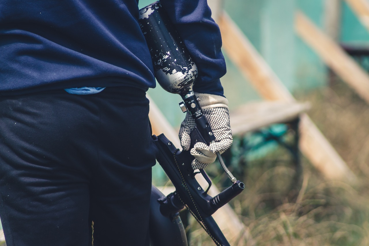 person holding black paintball
