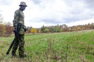 Man wearing green combat uniform ready for battle