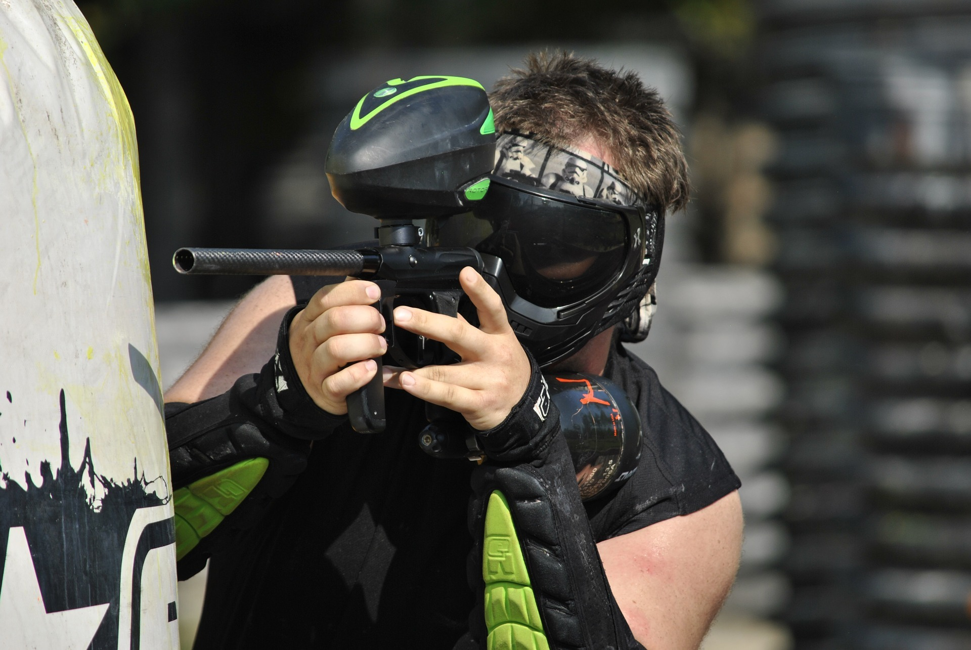 Man playing Paintball Gun Shooting