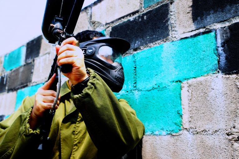 azodin blitz 3 review: a paintball player wearing a helmet and a marker